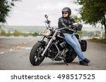 biker man sitting on his...   Shutterstock . vector #498517525