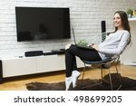 woman on a laptop sitting in... | Shutterstock . vector #498699205