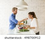 couple cooking together in the... | Shutterstock . vector #498700912
