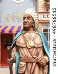 Small photo of Hong Kong - Oct 4, 2016 : Statue of Native American Indian in front of a Goldsmith shop. From his eagle feather headdress indicates he's probably a Native American Indian, a tribe leader from Idaho.