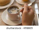 Man's Hand Stirring Coffee
