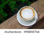 cup of coffee on a nature... | Shutterstock . vector #498840766