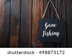 Gone Fishing Sign Written In...