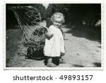 Vintage photo of baby (1955) - stock photo