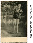 Vintage photo of woman in swimming suit (circa 1950) - stock photo