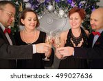 two happy couple clink glasses... | Shutterstock . vector #499027636