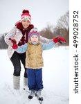 mother and her little son skate ... | Shutterstock . vector #499028752