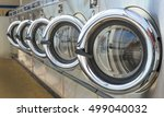 Stock photo row of industrial laundry machines in laundromat 499040032