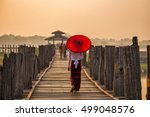 Burmese Girl Holding A Red...