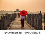 Burmese Girl Holding A Red...