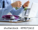 male doctor using a laptop ... | Shutterstock . vector #499072612