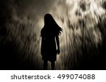 girl walking in the woods... | Shutterstock . vector #499074088