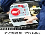 mechanic with laptop near car... | Shutterstock . vector #499116838