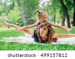 mother with daughter lying on... | Shutterstock . vector #499157812