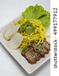 Small photo of Dry yellow noodle thai food on Aluminum bronze