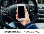 woman in car holding a white... | Shutterstock . vector #499188742