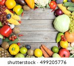 ripe fruits and vegetables on... | Shutterstock . vector #499205776