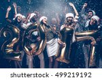 wishing a happy new year. group ... | Shutterstock . vector #499219192