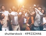 Small photo of They are unstoppable. Group of beautiful young people dancing together and looking happy