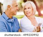 happy senior couple looking at... | Shutterstock . vector #499233952