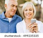 happy senior couple looking at...   Shutterstock . vector #499235335