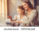beautiful young mother and her... | Shutterstock . vector #499246168