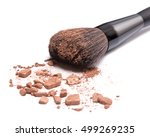 Stock photo close up of makeup brush with crushed bronzing powder on white background bronzer to face 499269235