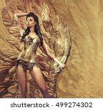 glamorous brunette beauty posing | Shutterstock . vector #499274302