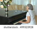 Elderly Woman Playing The Pian...