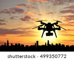 Silhouette Flying Drones Over...