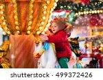 happy little girl in warm red... | Shutterstock . vector #499372426