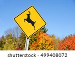 Deer Crossing Sign In Front Of...