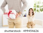 young man offering a gift to... | Shutterstock . vector #499454626