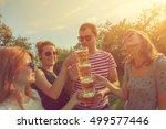 friends enjoying outdoors with... | Shutterstock . vector #499577446