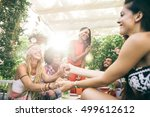 group of friends having party... | Shutterstock . vector #499612612