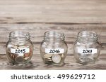 money in the glass on wood... | Shutterstock . vector #499629712