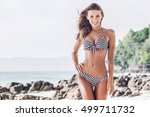 woman in bikini walking on... | Shutterstock . vector #499711732