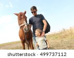 Man In Glasses With Her Son At...