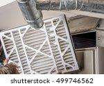 handyman inspects a filter from ... | Shutterstock . vector #499746562
