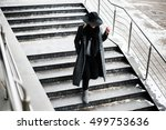 Woman In A Hat Walking Down Th...