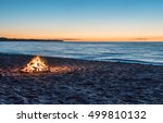 Bonfire On The Beach At Sunset
