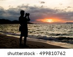 sunset photographer in siluate | Shutterstock . vector #499810762