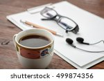 coffee on wood table.  pen ... | Shutterstock . vector #499874356