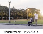 blurry   happy mother holding a ... | Shutterstock . vector #499973515