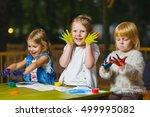 Children Having Fun Painting...
