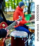 male buskers on autumn outdoor... | Shutterstock . vector #500050306