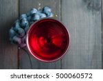glass of red wine and grapes on ... | Shutterstock . vector #500060572