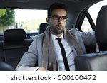 businessman on the move in car | Shutterstock . vector #500100472