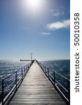 Sun shines on Jetty at Port Victoria, South Australia - stock photo