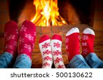 Family In Christmas Socks Near...